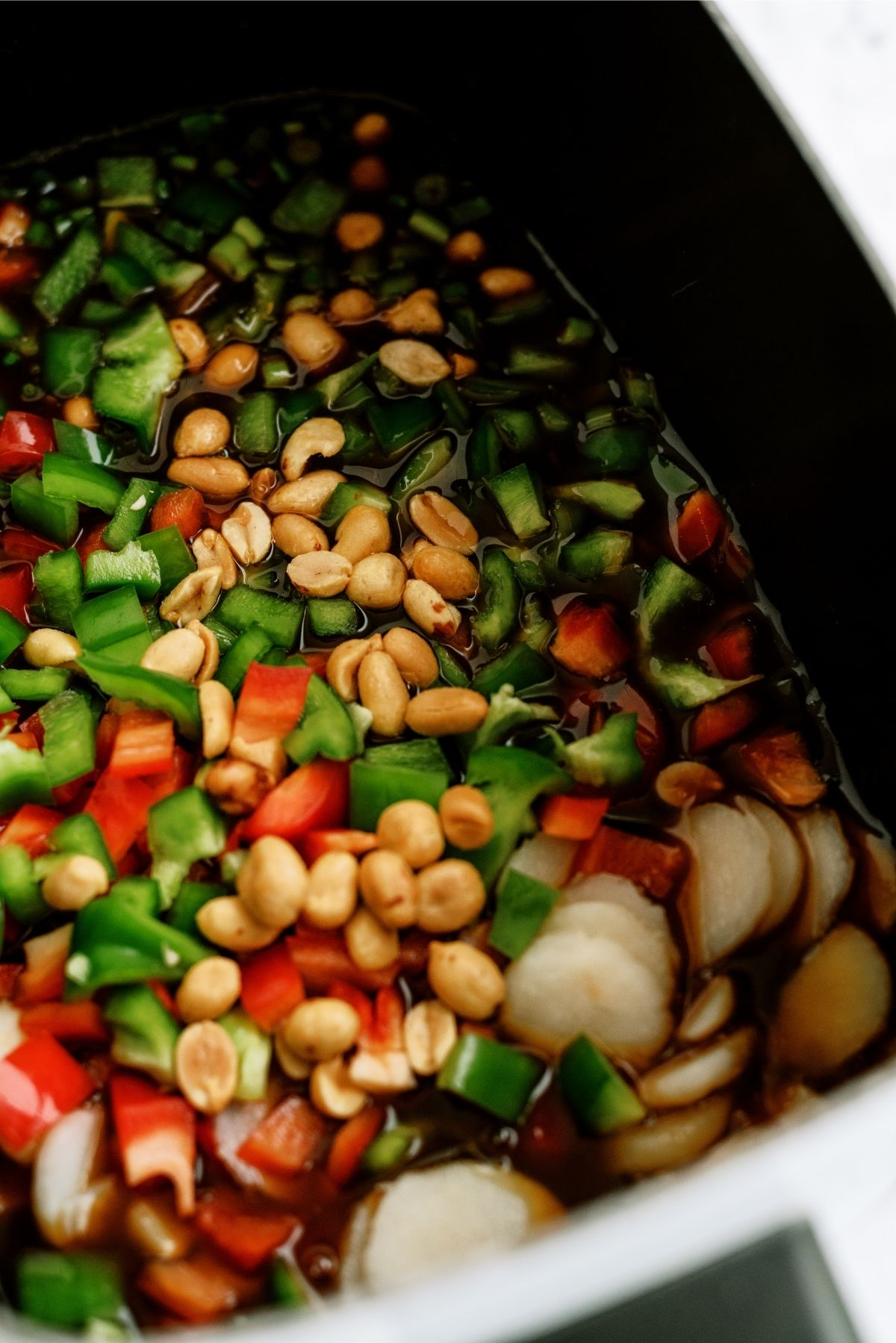 All ingredients for Slow Cooker Kung Pao Chicken inside the Slow Cooker