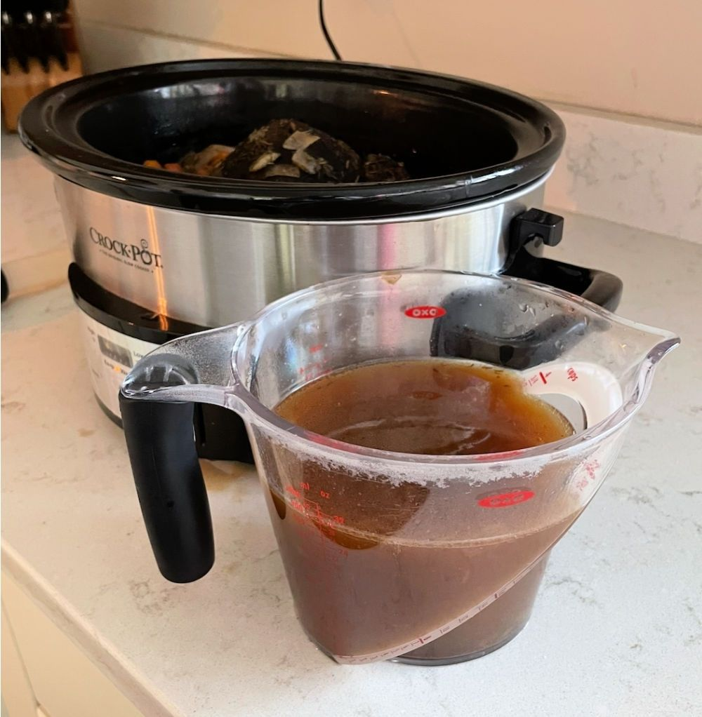 drippings removed from slow cooker to make gravy