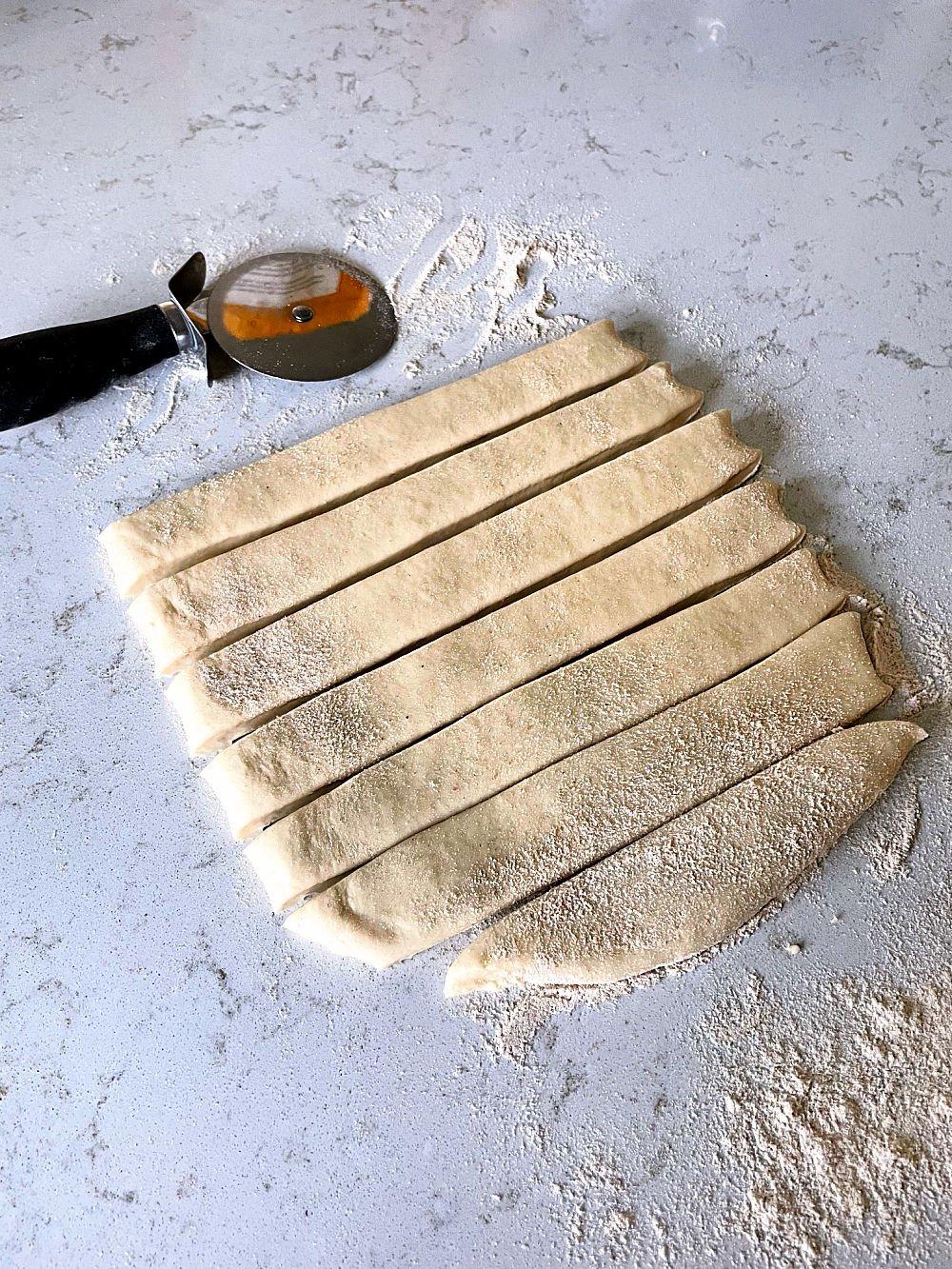 bread dough cut into strips for breadsticks