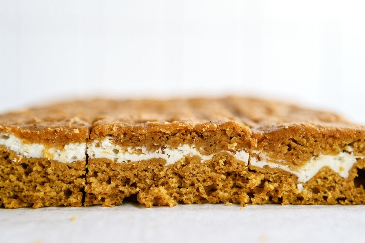 Cream Cheese and Pumpkin Roll Bars cut into squares