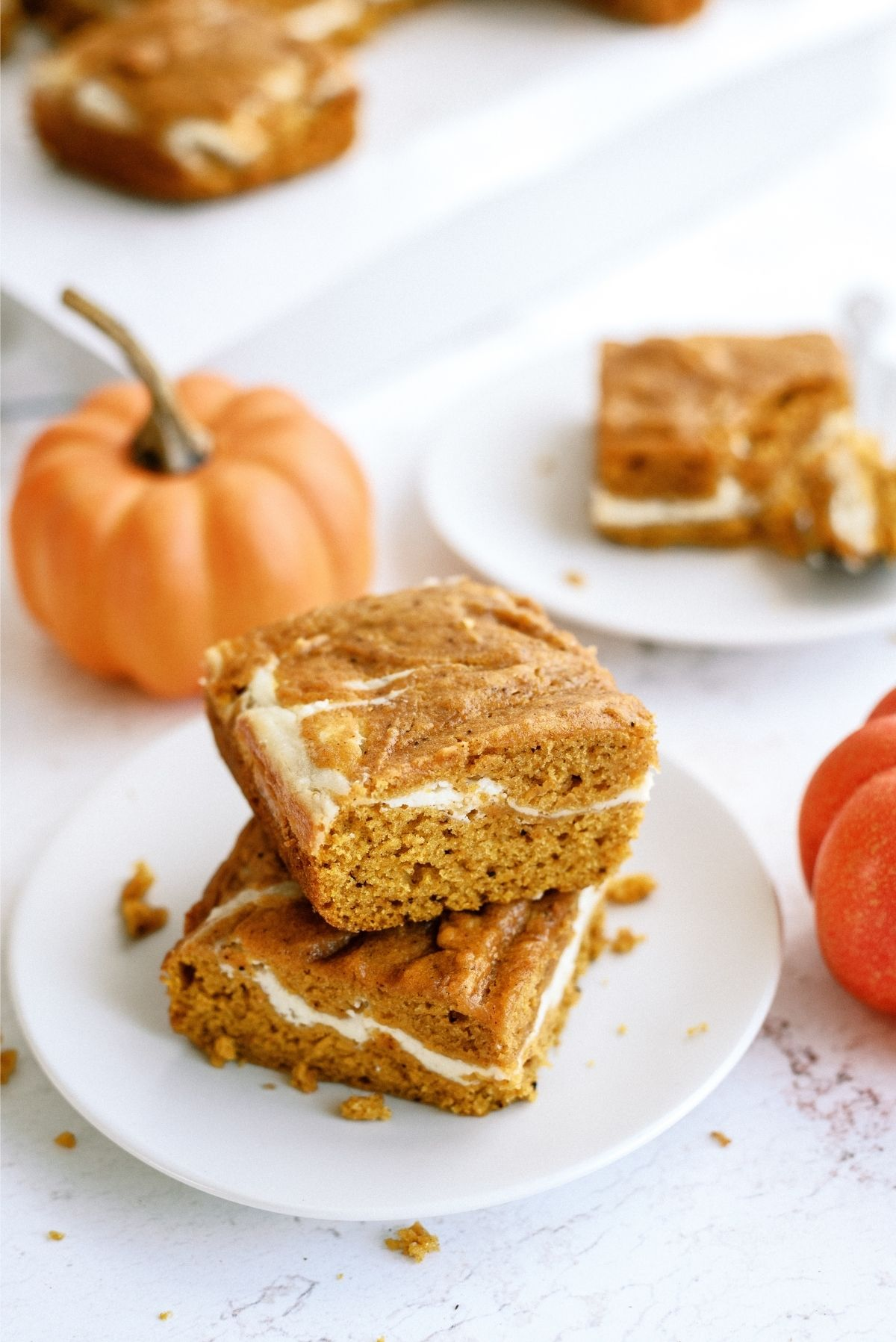 2 Cream Cheese and Pumpkin Roll Bars stacked on a plate