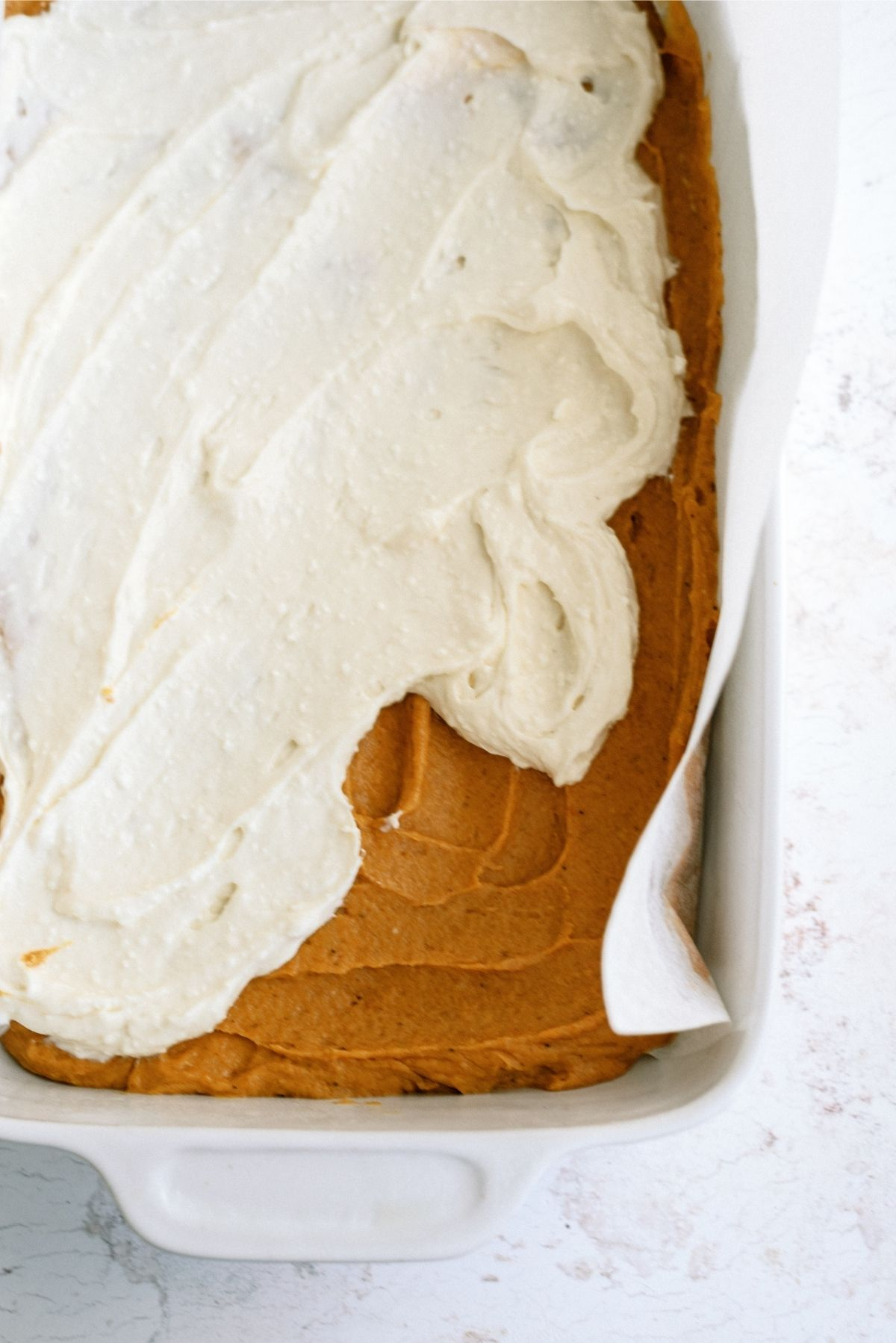 Cream cheese layer spread over bottom pumpkin layer