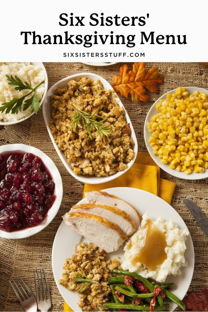 table spread with thanksgiving dinner and all the fixings